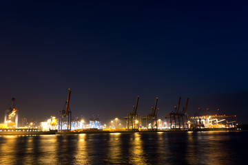 cranes and vessels at container terminal burchardkai in hamburg
