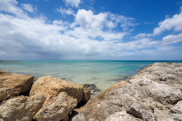 Sea landscape, horizon over water with clouds and rocks in Guadeloupe