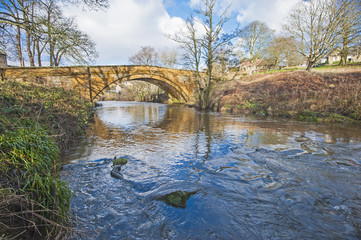 Old stone bridge over a stream