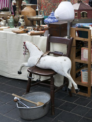 Flea market with old-fashioned goods displayed in London city,