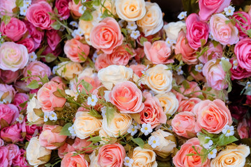 Floral background. Lot of artificial flowers in colorful composi