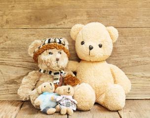 Teddy Bear toy on wood grunge background