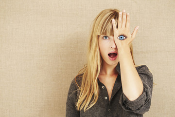 Shocked blond woman with painted eye