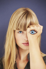 Young blond woman with painted eye