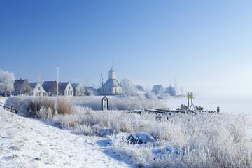 Fototapete - The village of Durgerdam, Netherlands in a frozen landscape