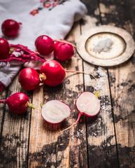 radish half with salt on rustic wooden background