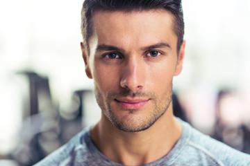 Handsome man at gym - fototapety na wymiar
