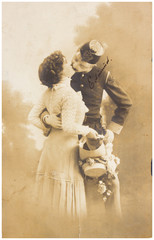 old photo of kissing woman and man