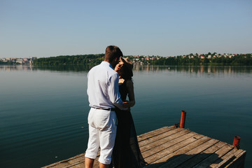couple spends time on the wooden pier