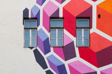 Windows surrounded by a colorful mural