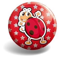 Red ladybug on round badge