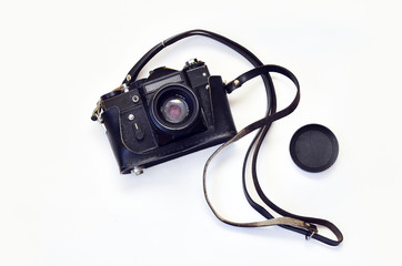 Old photo camera. Old photo camera on a white background. Camera in leather carrying case with strap, lens. Zenit.