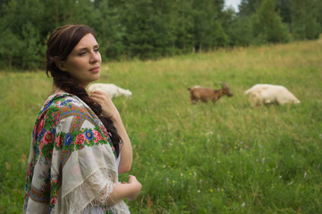 Russian woman herding goats