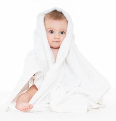 Beautiful happy baby  in a towel after bath. One, isolated on wh