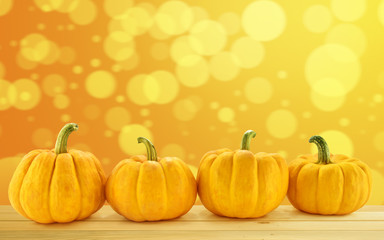 group of pumpkin on orange blur bokeh background
