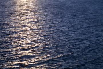 Background photo, sun glare on dark sea water