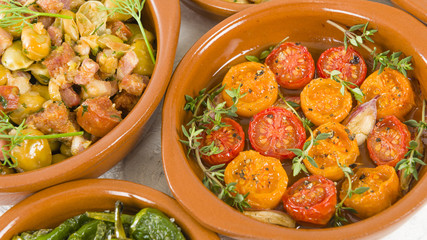 Spanish Tapas  - Tomates al Ajillo (Tomatoes with garlic), Pollo al limon con ajo (chicken with garlic) and Padron Peppers.