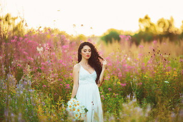 beautiful girl in the field, with long black hair