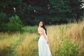 beautiful pregnant woman in white dress