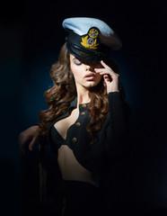 woman - sailor puts his cap on his head