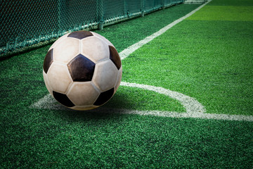 soccer ball on green artificial turf