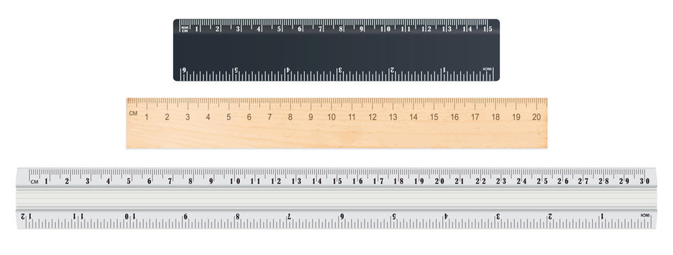 School rulers on white background