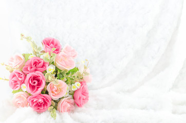 Pastel Coloured Artificial Pink Rose on white fur background