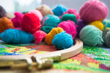 Woolen balls of yarn, tambour and embroidery. Close up