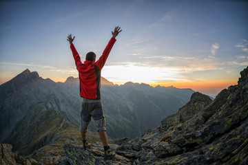 Hiker celebrating success in the sunset