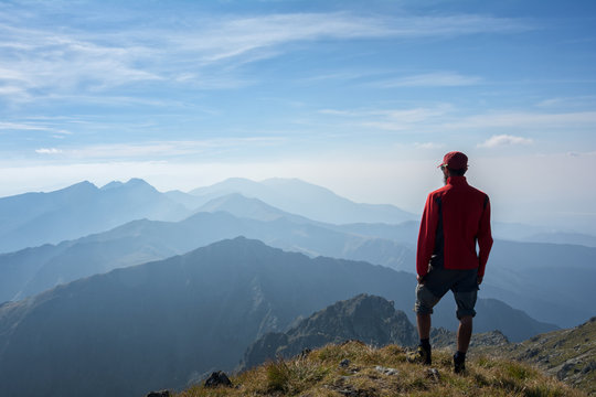 Hiker looking over the mountain ridges