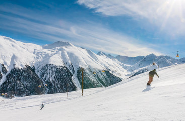 Skiers on the slope of  Ski resort Livigno. Italy