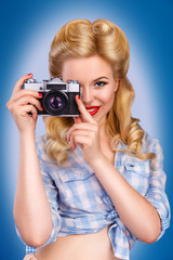 pin up girl photographed. Portrait Pin-up girl with a camera