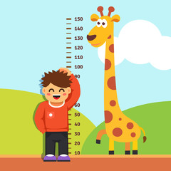 Boy kid measuring his height at kindergarten wall