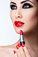 Professional Lips Makeup. Red Lipstick. Beauty Girl Applying Lip