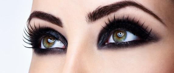 Closeup shot of woman eye with evening makeup. Long eyelashes. S