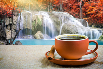 Espresso coffee cup with waterfall background