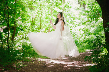 Beautiful happy young brunette bride outdoors in wedding dress,hairstyle, make-up, wedding, lifestyle