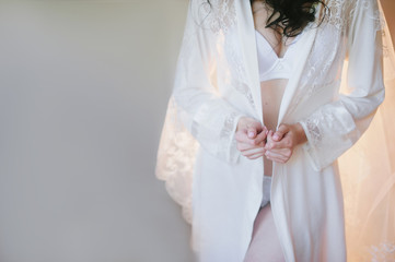 Beautiful hands of young bride in lingerie, youth, beauty, fees bride