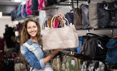 girl selecting handbag in commercial centre