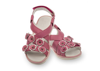 Girl pink sandal isolated.