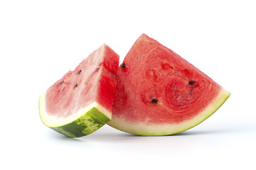 Two slices of watermelon on a white background..