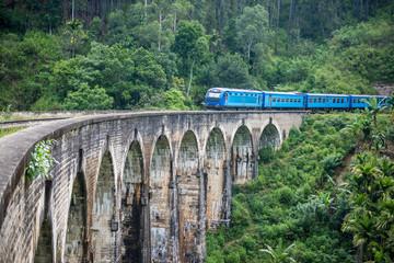 Train passing over Nine Arches Bridge in Demodara, Sri Lanka. One of major tourist attraction in Sri Lanka