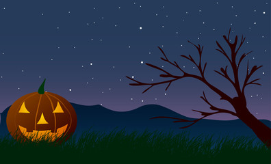 Halloween. Pumpkin on a background of tree and mountain.