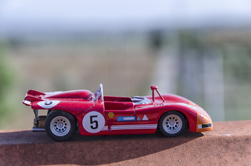 Model of a old racing car in the sun