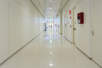Deep hospital corridor, detail of a white corridor in a hospital