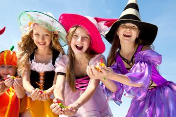 Halloween Girls Holding Candies