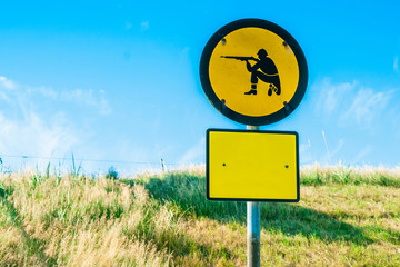 Shooting range sign in yellow