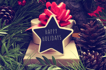 star-shaped chalkboard with the text happy holidays