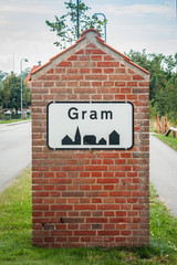 Gram city sign on a brick post