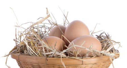 Egg,basket,straw on white background.